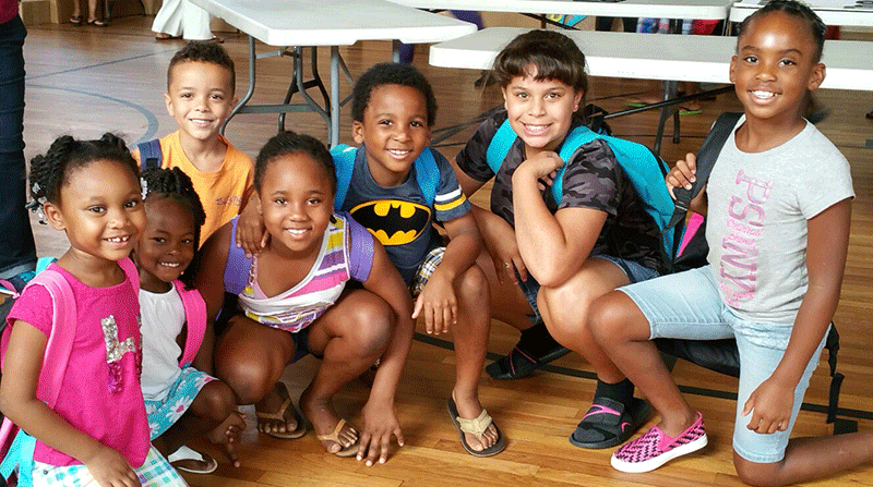 Ascend's Greenwood team donates backpacks to local students